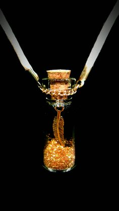 Gold Feather Charm in Fairy Dust Glass Bottle by CoutureRendezvous, $18.99