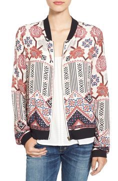 A cheerful geo-floral print adds some flower power to this on-trend bomber jacket that pairs perfectly with distressed denim.