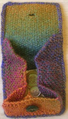 Folded Purse-This pattern is available as a free Ravelry download. The sides of this purse fold down when closed to keep your money safe but you can open them up to find the coins you want. The finished purse measures about 10 cm x 10 cm.