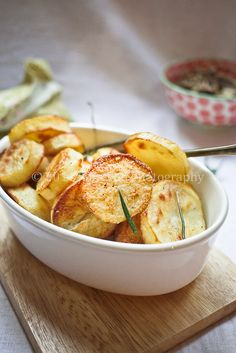 Jamie Oliver  Roasted Potatoes not sure about the rosemary..I am thinking just salt and pepper...maybe some onion!