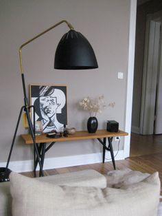 Grey room. fabulous black + gold/brass  floor lamps.