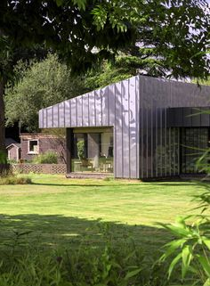 stainless steel panels were upcycled to wrap the home's brick and timber exterior, making it weather tight and giving it a slick, retro-futuristic appearance