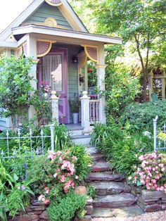 Small blue cottage, lavender door, steps, garden, porch