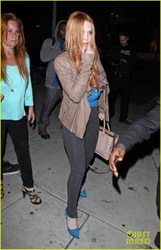 Lindsay Lohan was also spotted carrying the same light pink color Prada Saffiano Luxe Leather handbag while at the Gyu-Kaku Resturant on March 12th, 2012. This time Ms. Lohan wore a Rick Owens Blister Leather Biker Jacket of a turquoise blue top and grayish black skinny jeans and turquoise blue platform pumps that matched her blouse.
