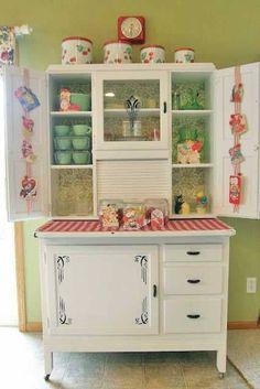 Beautiful Hoosier Cabinet.  Love the depression glass inside.