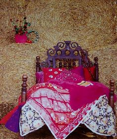 beautiful boho bed - love the colors, bed posts and headboard