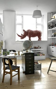 Obsessed with having a common play/homework room in our next house...maybe not a giant rhino ;)