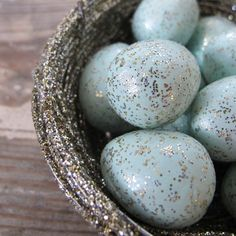 silver glittered nest with birds' eggs