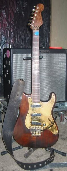 """Jamie West-Oram's (The Fixx) Pensa-Suhr guitar built by John Suhr with Schecter parts, EMG SA pickups, and original Floyd Rose bridge known as """"Woody""""."""