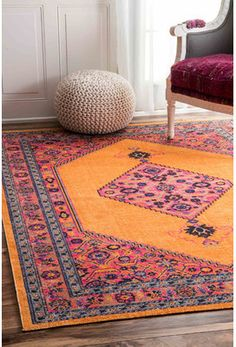 Wayfair Celena Orange Area Rug. This artistic patterned area rug in orange makes a lovely addition to a room needing a focal point or a little more interest. #afflink #arearugs #rugs #orangedecor #orangerug