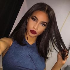Bold brows, bold red lips and smokey eyes