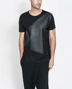 Image 1 of T-SHIRT WITH FAUX LEATHER APPLIQUÉ from Zara