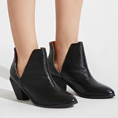 Nasty Gal N.Y.L.A. Side Slit Faux Leather Boots 7 Super on trend ankle boot with a black subtle shimmer upper, slanted stacked heel, slits at sides, and slightly pointed toe. Faux leather. Still on Nasty Gal for $78. Brand new without box, never worn. Nasty Gal Shoes Ankle Boots & Booties