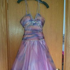 Poofy Prom/Homecoming Gown Women's Size 4 Worn for a homecoming dance one time. Poofy at the bottom. Unaltered. Does not appear to have any beading issues or tears. Dresses Prom