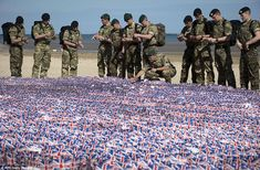 New generation: Royal Marine Commandos gather on Gold Beach at Asnelles, Normandy to read the tributes written to comrades who served 70 years before them - 6th June 2014