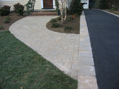 Invite guests in with the top 40 best driveway edging ideas. Explore unique border designs from brick to pavers, concrete, stone landscaping and beyond. Stamped Concrete Driveway, Concrete Pathway, Paver Walkway, Front Walkway, Concrete Driveways, Walkways, Driveway Entrance, Concrete Stone, Driveway Border