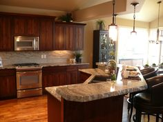 Cabinets that match brazilian cherry floors have natural for Acacia wood kitchen cabinets
