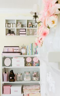Make clutter look less clutter-y by tying all your boxes and jars together with a common color.