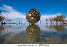 PESARO, ITALY - APRIL 30, 2017: The big sphere of Arnaldo Pomodoro on the sea of Pesaro #Pesaro #Sphere #ArnaldoPomodoro #Sfera #GrandeSfera #Marche #Sea #Travel #Water