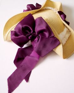 Turning a placemat into an 18th century hat.