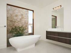 Aquabrass Turks free-standing bathtub. and Chicane faucet, seen in Monte Sereno Palm Springs, design by Poon design inc.