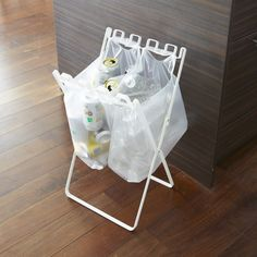 From Japanese company Yamazaki, the Recycling Bag Stand is an innovative accessory designed with urban living in mind. The simple accessory unfolds to a standing position that can hold several plastic bags—from grocery shopping, takeout, and other errands—enabling users to directly recycle plastic containers, cans, and other items into the bags.