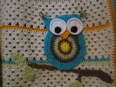 I used pattern for Oh So Cute Owl Purse from Mama G's Big Crafty Blog to make this owl for my baby shower gift.  I am so happy with how it looks!  I love love love the bright colors!