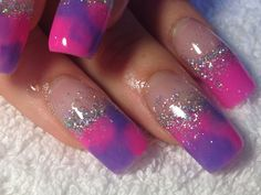 Acrylic nail extensions  with neon pink and neon purple with holographic silver randomly thrown on for some sparkle. We have also 'tye dye' (with only two colours) on 2 of the nails instead of the one