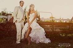 cowboy boots & wedding dress This pic made me think you need a pic of you two dangling feet off back of pick up, showing da boots<3