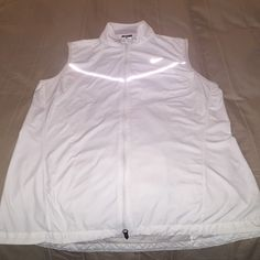 Nike wind vest - size L A stylish light vest with back pocket; perfect for golf, running, jogging; worn couple times but still in good shape Nike Jackets & Coats Vests