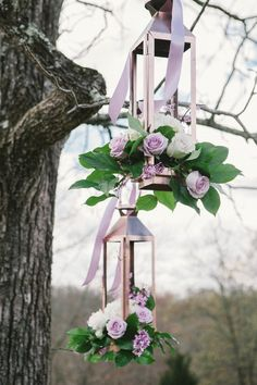 Hanging lanterns with roses and ribbon at this lavender inspired wedding. See more at thepinkbride.com | The Pink Bride® Photo credit: Simply Stated