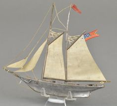Victorian Christmas ornament   German Dresden Two-Masted Sailing Sloop. Painstakingly handcrafted, totally rigged in full sail, complete with anchor, tiller wheel, lifeboats on deck, and flying the American flag.