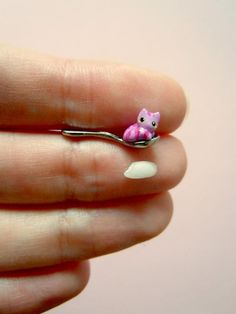 Tiny Cheshire Cat on a miniature spoon by MijbilCreatures on Etsy. $25.00 USD, via Etsy.