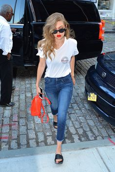 Pin for Later: The Most Popular Outfit of the Summer Is Something You Already Have in Your Closet Gigi Stepped Out in NYC in July, Styling Her White Tee With Cropped Skinnies and Black Slides