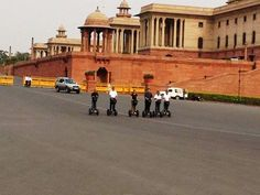"""Begin exploring the greatest monuments of New Delhi on this """"SEGWAY TOUR of Rajpath"""" through gliding and experience all of the great sights the city has to offer. You will cruise through fascinating facets of the city while hearing informative historic and current facts about the area from our tour guides and marshals. Bringing abundance of photo clicking opportunities of historic buildings, monuments and memorials you will be enthralled with this one of a kind touring experience. Glide past… Cycling Tours, India Gate, Walking Tour, Historical Sites, Tour Guide, Monuments, Abundance, Touring, Exploring"""