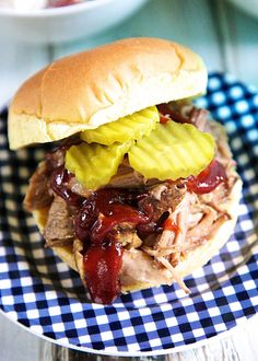Slow Cooker Zesty Pulled Pork Recipe - pork shoulder slow cooked all day in a mixture of garlic, onion, brown sugar, soy sauce and vinegar - our new go-to slow cooker pulled pork recipe!