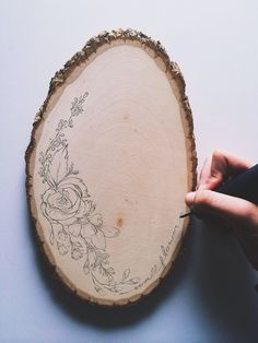 Grab a piece of wood like this from a craft store, a pen, and stencil. Easy way to decorate.