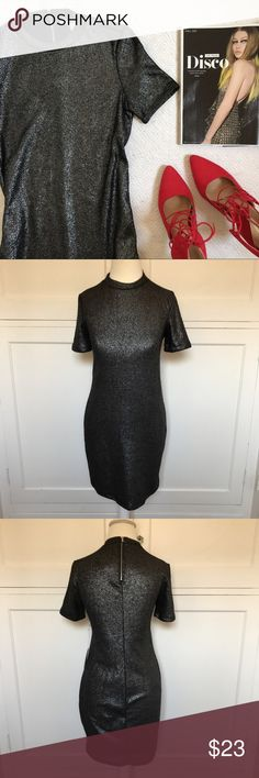 """💋PRICE FIRM💋 NWT Silver & Black Mini Dress 💋PRICE FIRM UNLESS BUNDLED💋 NO OFFERS ACCEPTED💋 The disco trend is here. If it sparkles or shines, you need it. Very cute silver and black mini with zipper detail in back. New with tags. 98% polyester, 2 % spandex. Hand wash cold. Has some stretch. Size small. Length is 32"""". 16"""" across at bustline. Unlined. Forever 21 Dresses Mini"""