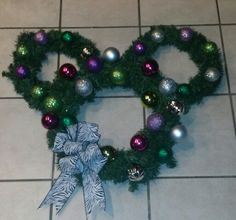 My 1st wreath I ever made its just two smaller wreaths tied with a coat hanger and the bulbs are from the dollar store. and whatever ribbon you like to make a bow that matches your style I got the idea from Disneyland