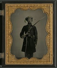 Sergeant John E. Barlow of 2nd Co. M, 1st Mississippi Cavalry Regiment with sword and revolver.  Liljenquist Family Collection, the Library of Congress.