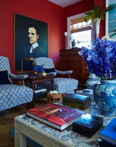 Living room in red & blue by William McClure in Birmingham