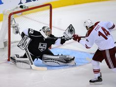 LOS ANGELES, CA - MAY 20: Goaltender Jonathan Quick #32 of the Los Angeles Kings makes a save on a shot by Taylor Pyatt #14 of the Phoenix Coyotes in the second period in Game Four of the Western Conference Final during the 2012 NHL Stanley Cup Playoffs at Staples Center on May 20, 2012 in Los Angeles, California. (Photo by Harry How/Getty Images)