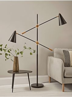With the most fabulous contemporary design, our statement floor lamp will make a striking feature in any room of your home. Each lamp features two arms, each with an adjustable, conical shade to the end, with a matte black finish and brass details. Lighting Uk, Luxury Lighting, Modern Lighting, Industrial Floor Lamps, Modern Floor Lamps, Black Floor Lamp, Led Floor Lamp, Farmhouse Floor Lamps, Steampunk