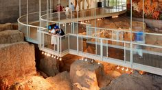Visitors observe fossils from a suspended walkway in the dig shelter. Waco Mammoth National Monument Texas