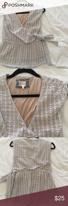 anthropologie white lined wrap-style blouse great condition. unique design. fully lined but you may wish to wear with a camisole to reduce the deep neckline. Anthropologie Tops Blouses