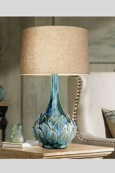Possini Euro Kenya Blue Green Ceramic Table Lamp. Hues of blue and green combine in this stunning ceramic table lamp design. The base features a petal detail reminiscent of a blooming flower. Topped with a light brown drum linen lamp shade. #tablelamp #lighting #ceramiclamp #blueceramiclamp. *aff*