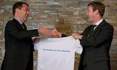 Russian prime minister Dmitry Medvedev shakes hands with Facebook chief, Mark Zuckerberg