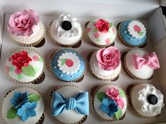 Cupcakes full of flowers including hand painted cupcakes