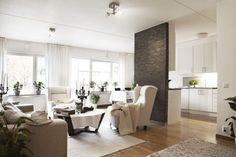 Látványos térelválasztás nyitott nappali és konyha között