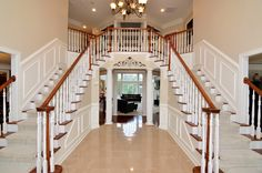Traditional Staircase with Wainscoting, MS International Marble Crema Marfil Select Tile, Hardwood floors, High ceiling